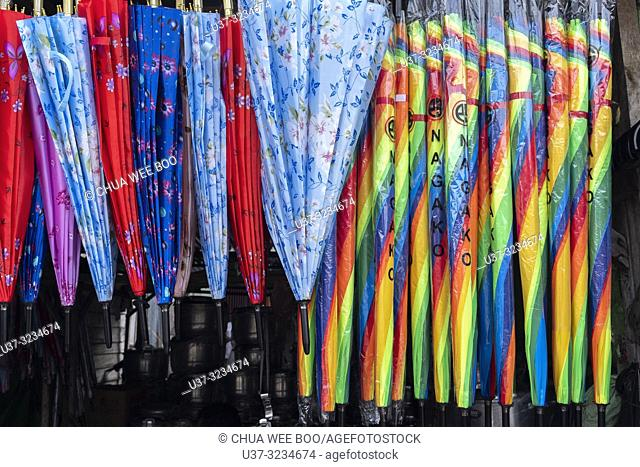 Hawker stalls selling colourful umbrellas at Serikin Malaysia-Indonesia Border