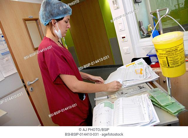 Reportage in the Rothschild Foundation's intensive care unit in Paris, France. A nurse preparing treatment