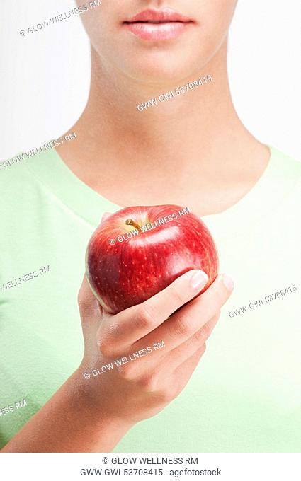 Close-up of a woman holding a red apple