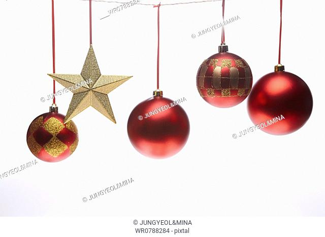 The red Christmas ball decorations and gold star