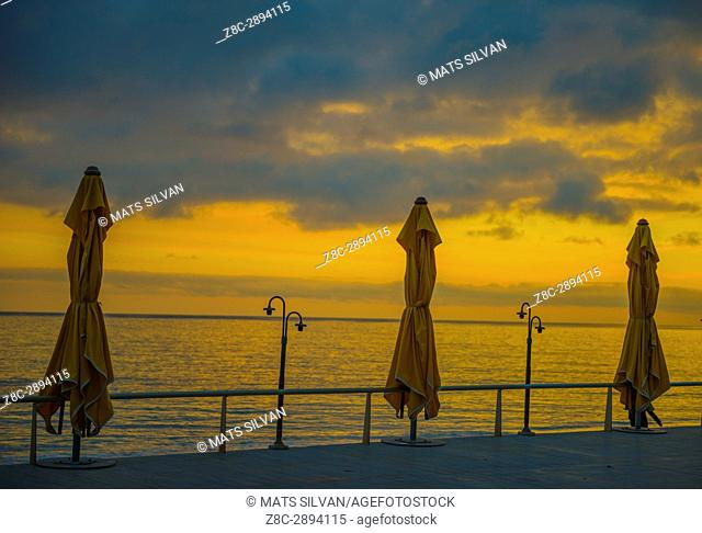 Parasol on the Coastline to Mediterranean Sea in Sunset in Menton, Provence-Alpes-Côte d'Azur, France