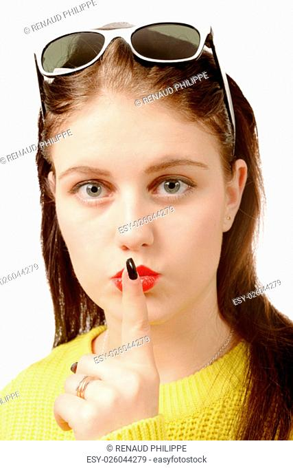 Young woman put her finger to her lips. On white background