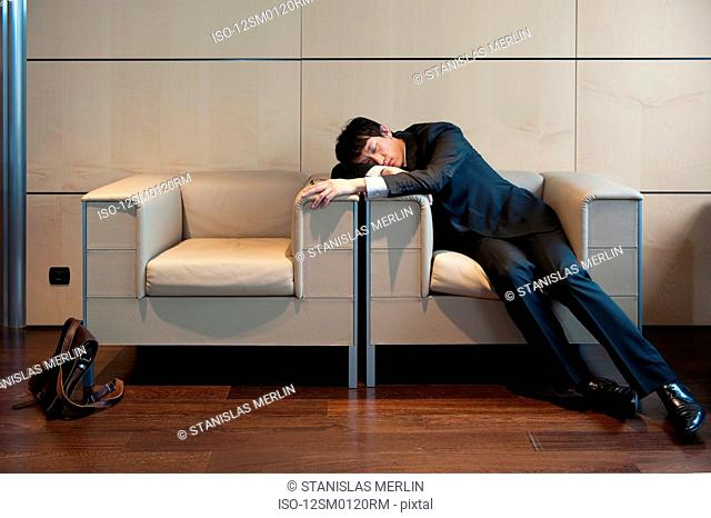 Chinese businessman sleeping in office