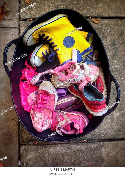 Basket full of children shoes