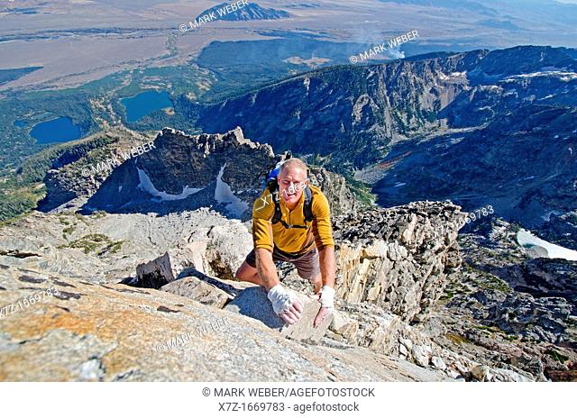 Free solo rock climbing The Direct South Ridge route which is rated grade 3 at 5,7 on Nez Perce Peak in Grand Teton National Park in northern Wyoming