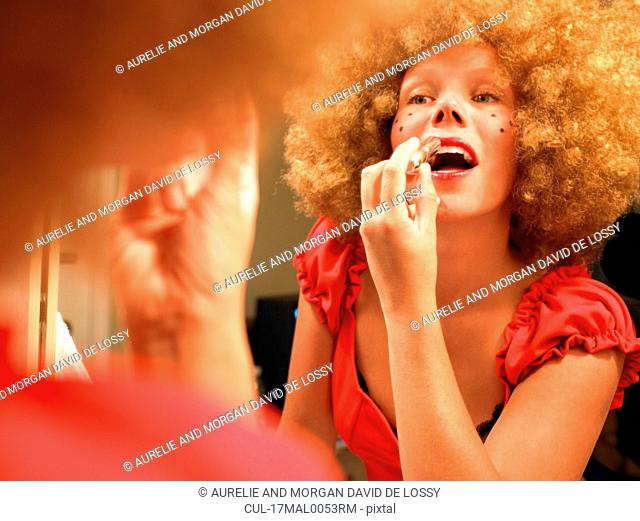 Woman putting on make-up