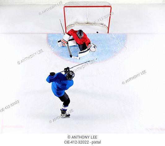 Hockey player scoring a goal