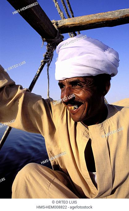 Egypt, Aswan, felucca on Nile river and its captain