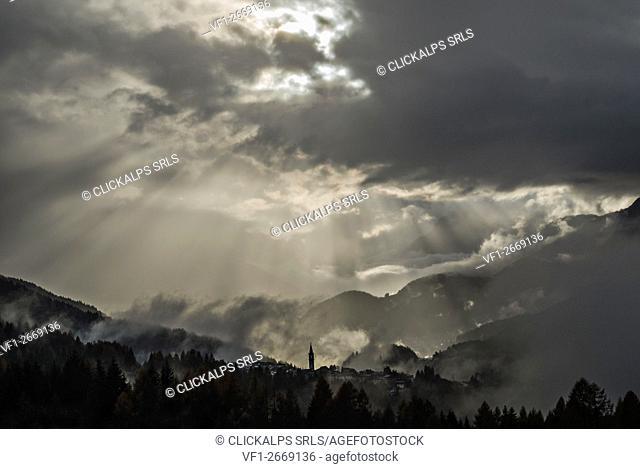 Lorenzago di Cadore, Dolomites, Veneto, Italy. Sun rays over Lorenzago di Cadore