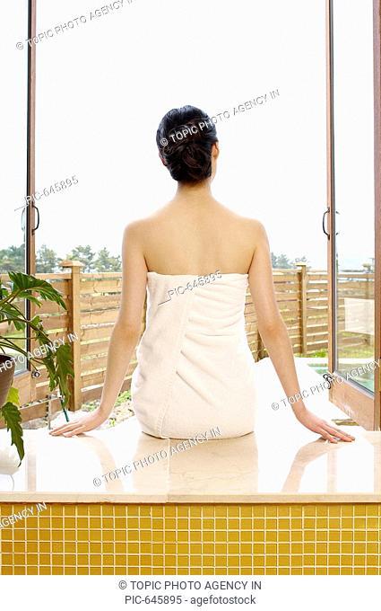 Woman Wrapped in Towel Sitting on the Edge of Bathtub,Korea