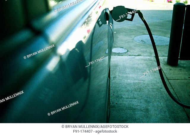 Car filling up with gasoline