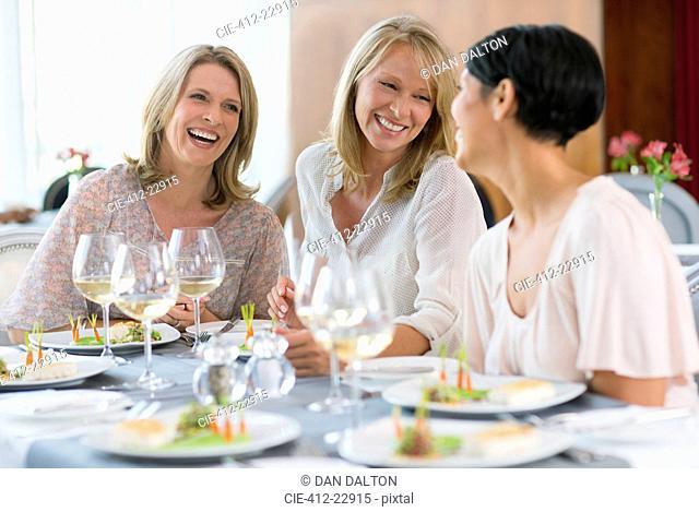 Women enjoying meal in restaurant