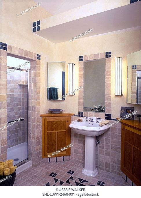BATHROOM - Mission style oak corner cabinets, pedestal sink, and shower with glass door. Tumbled marble tiles in geometric design