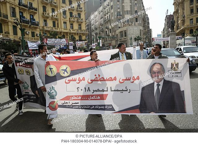 Supporters of Presidential candidate and leader of the Liberal el-Ghad Party, Moussa Mostafa Moussa, hold his campaign banners during a pre-election campaign...
