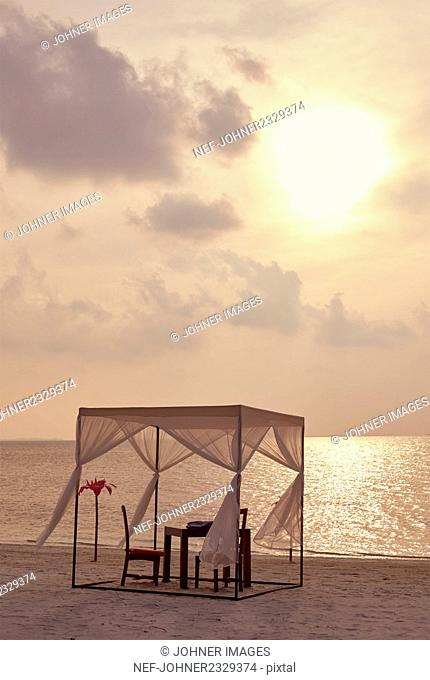 Gazebo on beach at sunset