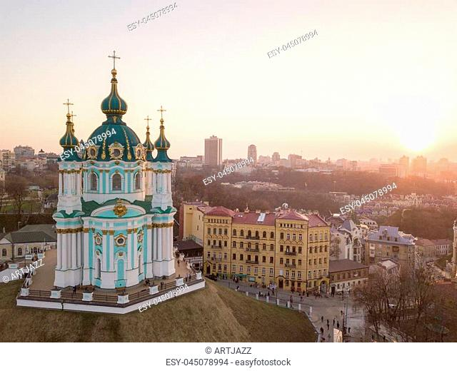 Aerial top view of Saint Andrew's church and Andreevska street, cityscape of Podol district city of Kiev , Ukraine. Drone photo