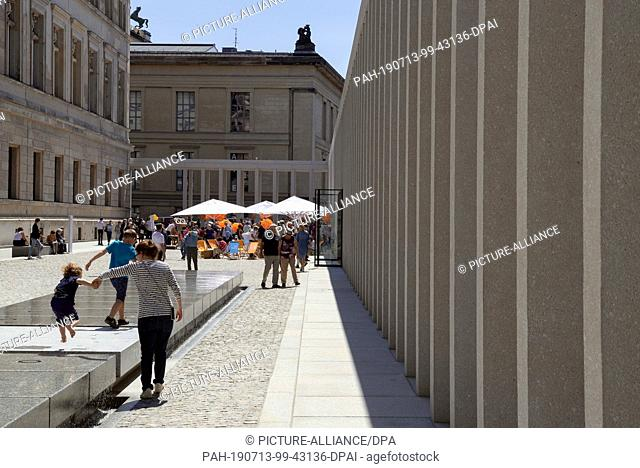 13 July 2019, Berlin: After the opening of the James Simon Gallery, visitors walk alongside the new building. The National Museums have invited to the opening...