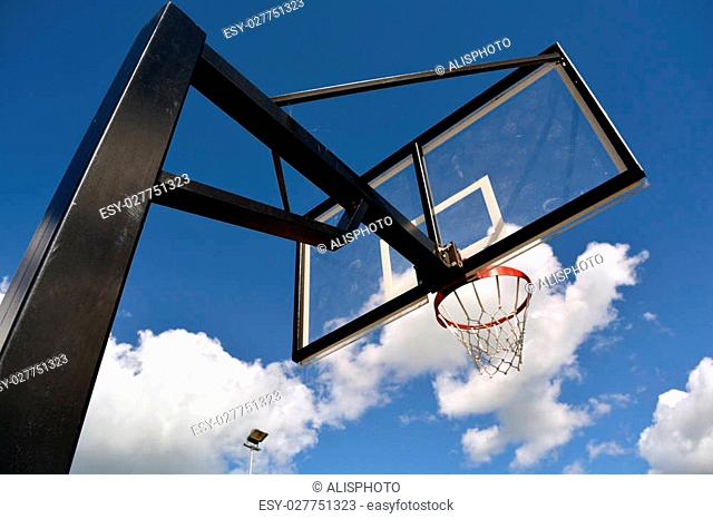 Basketball stand with a hoop outdoors
