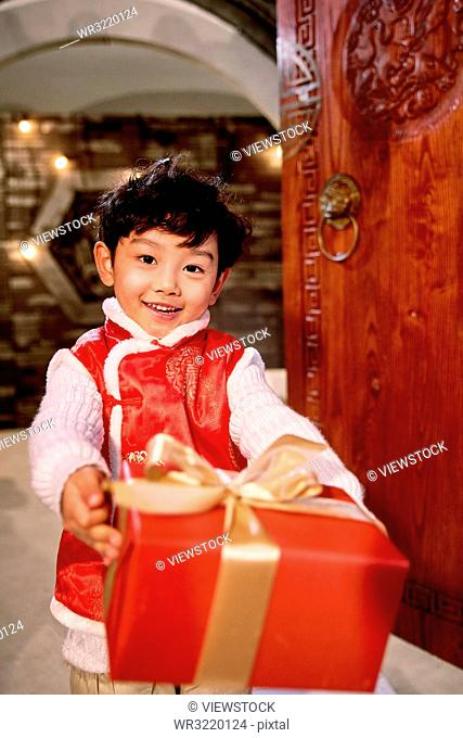 Lovely boy with a gift box