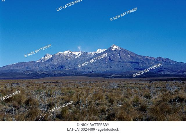 View across landscape to Mount Ruapehu. 9170 Feet.Snowcapped