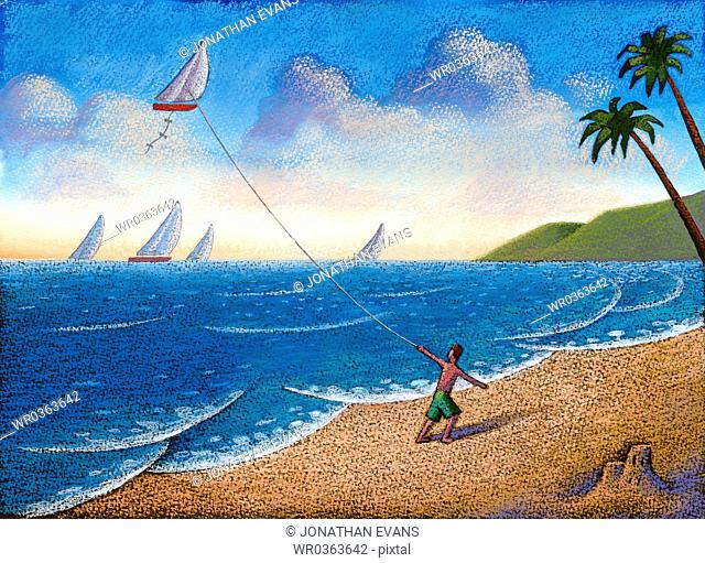 Young boy flying a kite shaped like a sailboat on the beach