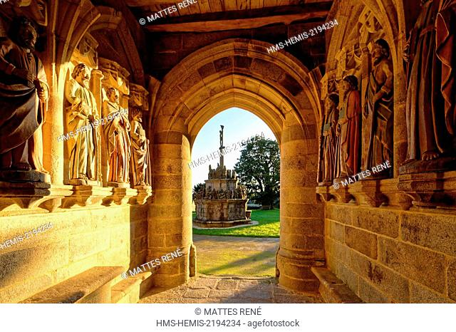 France, Cotes d'Armor, Kergrist Moelou, parochial enclosure, polychrome statues of the apostles under the porch of the Holy Trinity church and the calvary