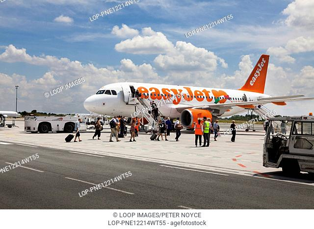 Passengers walking to Easyjet aircraft for boarding