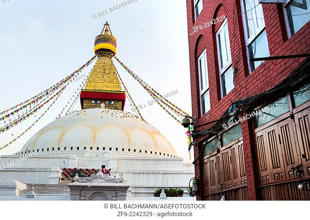 Kathmandu Nepal Boudhanath Stupa at the famous religious temple with modern building in foreground