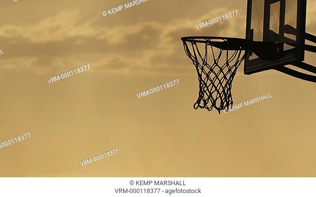 WS Silhouette of man playing basketball / Salt Lake City, Utah, USA