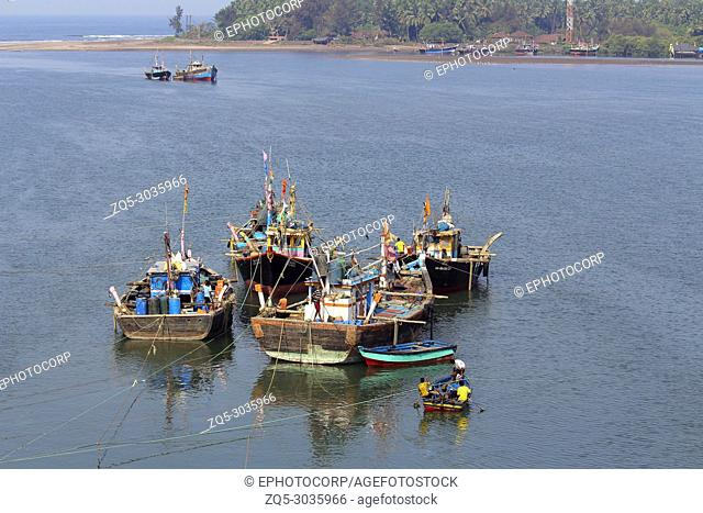 Four fishing boats with sea in a background at Anjarle, Kokan