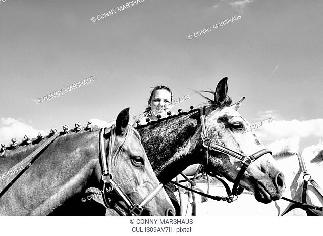 B & W image of woman with horses