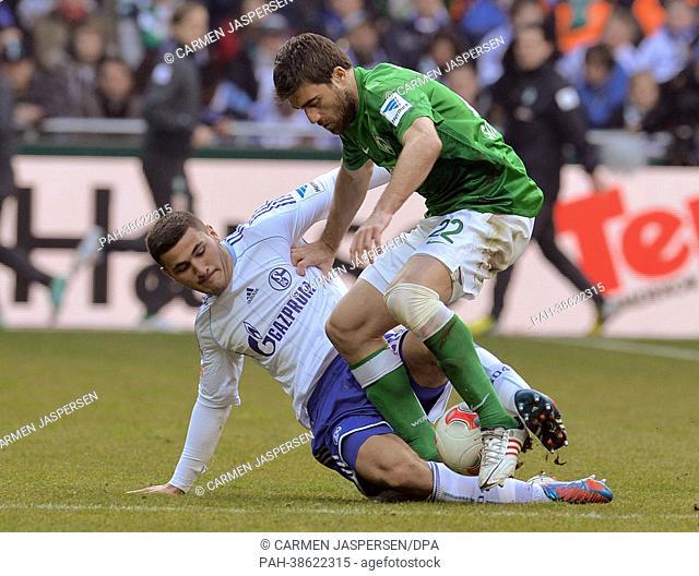 Werder's Sokratis (R) vies for the ball with Schalke's Sead Kolasinac during the Bundesliga soccer match between Werder Bremen and FC Schalke 04 at Weser...