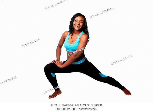 Happy woman doing workout fitness stretching exercise to feel good, bodycare concept, isolated