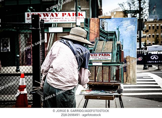 Street artist drawing the fenway park, Boston