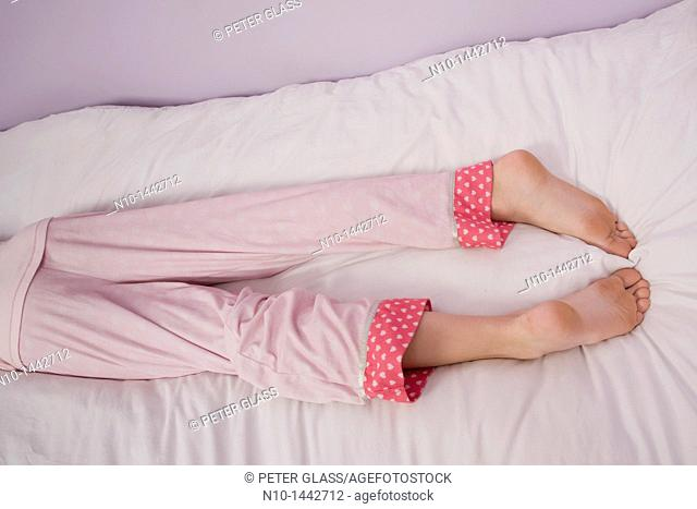 Preteen girl's legs and feet