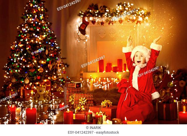 Christmas Child Happy Presents Gifts, Kid Opening Present Toys in Xmas Tree Decorated Room