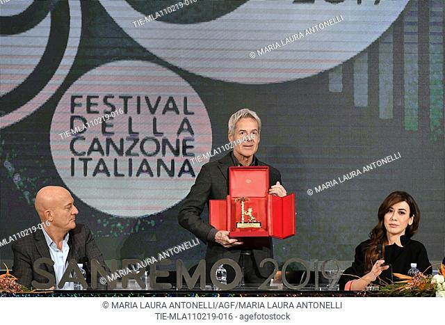 Claudio Bisio, Claudio Baglioni shows the 'Amico di Sanremo' Award (Friend of Sanremo), Virginia Raffele during the final press conference of 69th Sanremo Music...