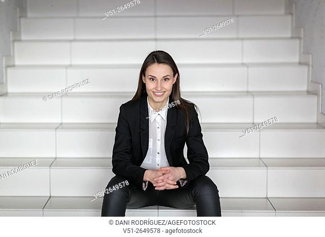 Portrait of a pretty woman in the office looking at camera