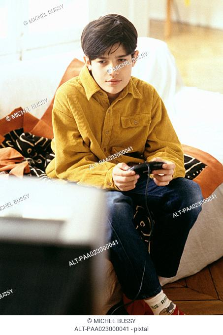 Boy playing video games on couch