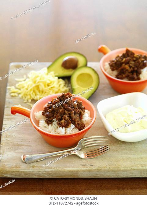 Chilli con carne on rice with ingredients