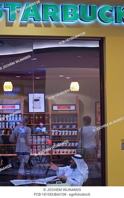 Dubai, arabs in Starbucks in the Mall of the Emirates