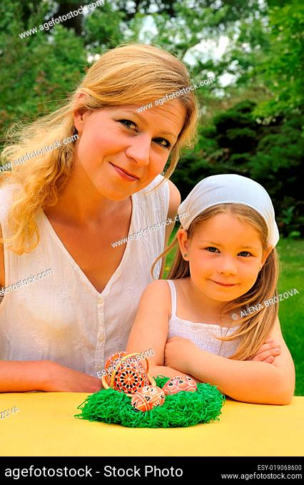 Young mother and daughter having Easter time