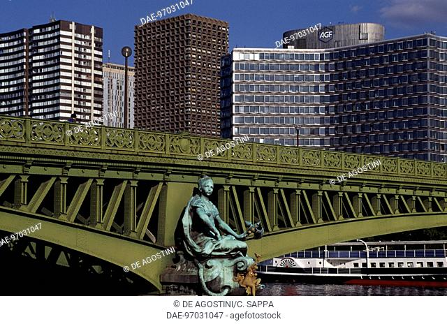 View of Pont Mirabeau and skyscrapers, Paris, Ile-de-France, France