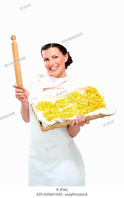 young beautiful woman showing homemade fresh pasta on white