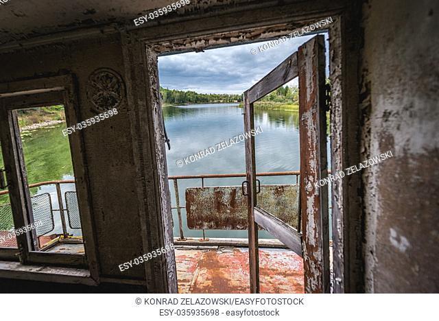 Inside the sinking boat on a Yanov backwater in Pripyat ghost city of Chernobyl Nuclear Power Plant Zone of Alienation in Ukraine