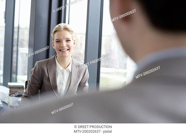Colleagues counseling interview in office, smiling