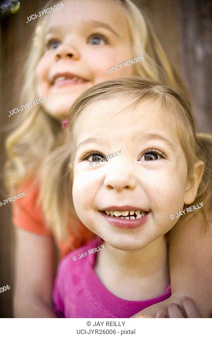 Close up of young girls smiling