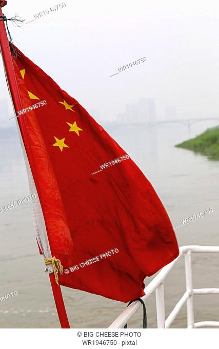 Chinese flag on the stern of a riverboat, Leshan, Sichuan province, China