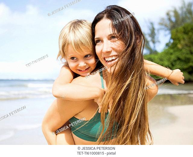 Mother with daughter (2-3) on beach