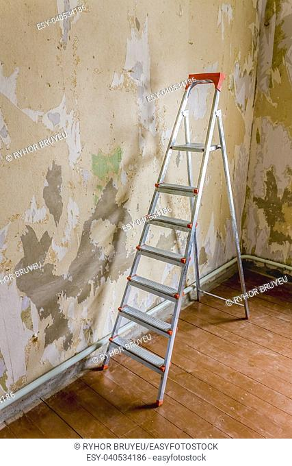 Old Wallpapers And Metallic Ladder
